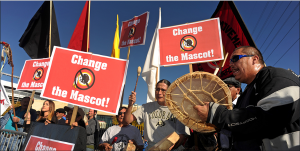 brand activism - protestors protesting the name of the Washington Redskins.