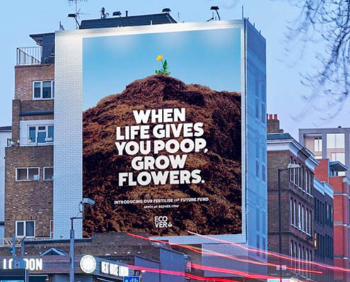 """sustainability marketing - a sign reading """"When life gives you poop, grow flowers"""""""